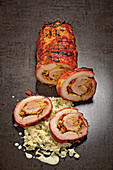 Pork belly roulade with chorizo made in a smoker