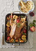 Roast goose on honey with apples and curls