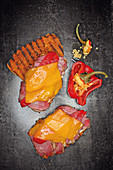 Grilled pastrami sandwiches with peppers and Cheddar cheese