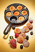 Grilled, alcoholic pffertjes with chocolate cream