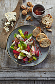 Vegetable salad with cheese and caramelized nuts