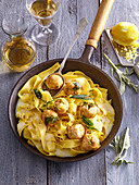 Pasta with chicken balls and lemon sauce