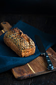 Seed loaf of bread with bread knife
