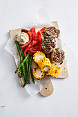 Feta and mint beef patties with grilled vegies and hummus