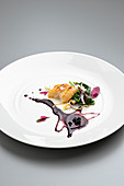 Sturgeon with horseradish, blueberries and tree spinach