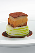Pork belly with radish cake, cocoa and an olive reduction