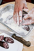 Slices of black pudding being dusted in flour
