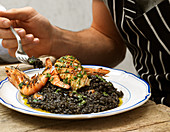 Squid ink risotto with seafood