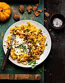 Pumpkin pasta with feta and walnuts