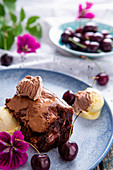 Chocolate and cherry brownies with ice cream