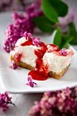 Sour cream dessert with strawberry sauce
