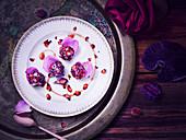 Laddu (Indian dessert) with rose petals