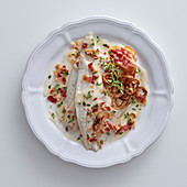 Sea bream fillets with bacon in white wine, cream and tarragon