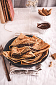 Crepes with chocolate cream and nuts