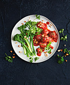 Spinach felafel in tomato sauce