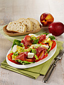 Summer salad with mozzarella, nectarines and Parma ham