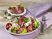 Roast potato salad with roast beef and radishes