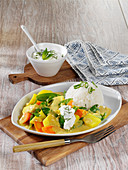 'Coco Jumbo' potato curry with a creamy yoghurt