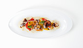 Fried octopus with mignonette sauce and tomato polenta
