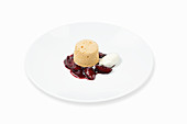 Caramel soufflé with roast plums and sour cream ice cream