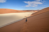 Hiker on sand dune, Namibia