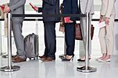 Business people standing in queue