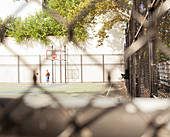 Man playing basketball on urban court