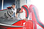 Racing team working on car
