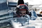Racer sitting in car