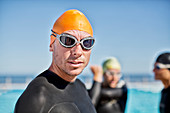 Triathletes in wetsuits with goggles