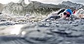 Swimmers splashing in water