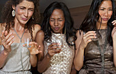 Women having shots drinks at party