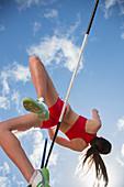 High jumper clearing bar