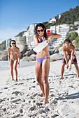 Woman playing paddle ball on beach