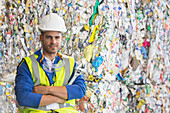 Worker by compacted recycling bundles