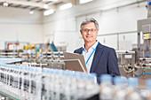 Supervisor smiling in bottling plant