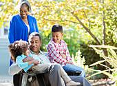 Grandparents and grandchildren in garden