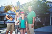 Smiling Family with baseball bat
