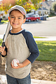 Smiling boy with baseball and bat