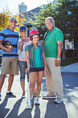 Happy Family playing baseball in street