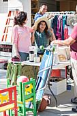 People shopping at garage sale