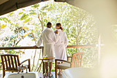 Couple in bathrobes standing in spa