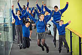 Students smiling and jumping
