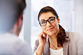 Smiling woman in glasses with client