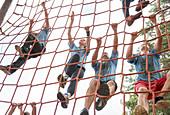 Team climbing net on boot camp course