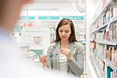 Customer looking at price tag