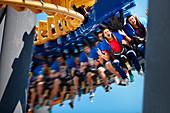 Man screaming on amusement park ride