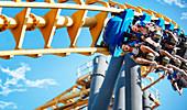 Friends riding amusement park ride