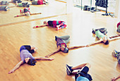 Exercise class doing twisted stretch