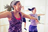 Women enjoying aerobics class